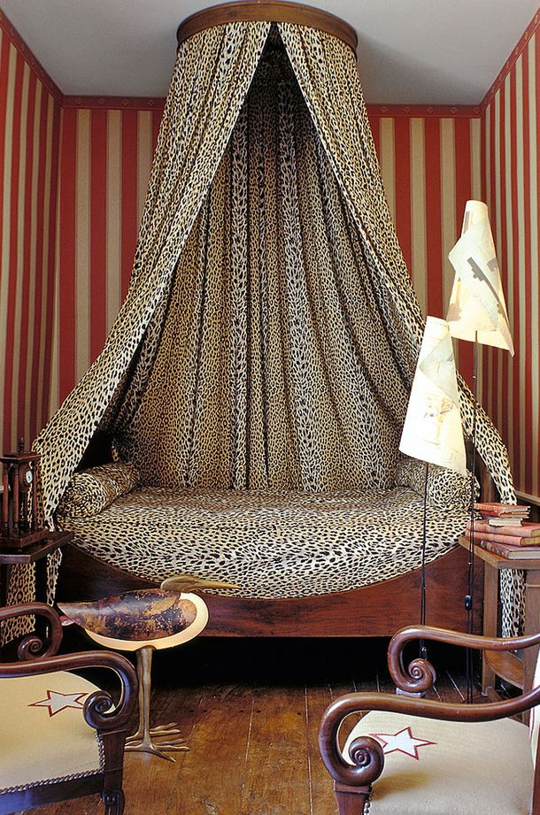 Room of the Day: love the leopard draped bed, red and cream striped walls, chairs and that duck ~ Home in France, the designer Marc Boisseau. 8.20.2013
