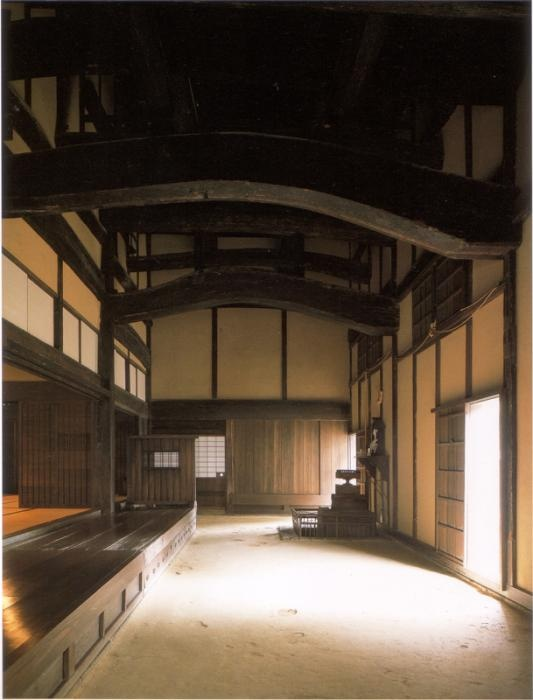 Interior of a Minka, or traditional japanese farm house. This view is the animal entrance where cows and horses can come part way into the house in winter or extreme weather. Typically it has a dirt floor like the kitchen fire pit area. I think the lowest level of my in the hill home would have this for the gathering in option that I plan to use during forest fires and tornados.