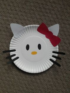 Hello Kitty paper plate craft! Just cut shapes from scrapbook paper and glue to plate. Would be an easy party craft!