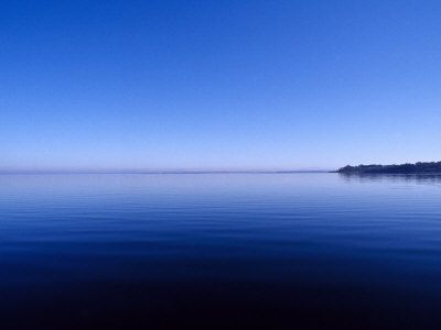 Clear Blue Sky Reflected in a Still Lake Surface, Metung, Gippsland Lakes, Victoria, Australia.