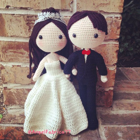 This is a finished handmade amigurumi crochet dolls of a bride in white wedding ballgown dress and a groom in black suit. There are beads and lace