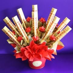Surprise someone with this bright and beautiful chocolate bouquet! Comes filled with 10 Toblerone chocolate bars and 11 deliciously creamy...