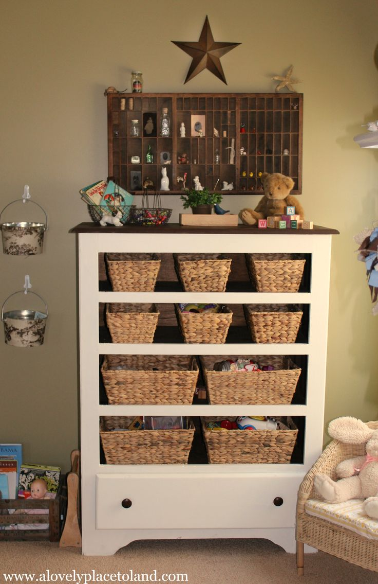 Cute for a mudroom! Broken dresser, all fixed up with baskets to hold gloves and socks and boots. CUTE!