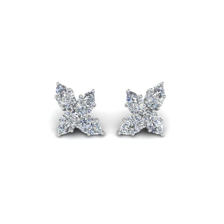 Shop cluster pear diamond earring in 950 platinum at Fascinating Diamonds. This Earrings for Women can be customized as per your desire. #DiamondEarrings