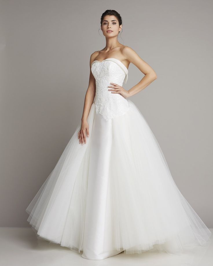 Cute Romantic ball gown wedding dress Tulle skirt and embroidery on the bustier add preciousness to