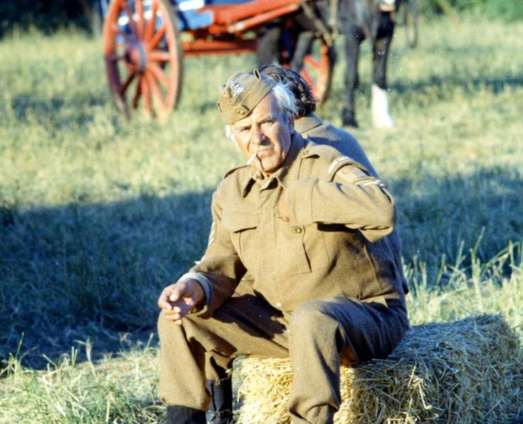 Taking it easy: John Le Mesurier has a cigarette break between shots at Walnut Tree Farm...