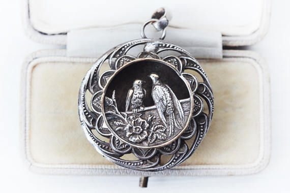 This is a rare Victorian era swallow lovebirds and rose shadowbox sterling silver plated huge statement necklace. Large size, over 2 inches with bale! Very detailed swallows, rose, wood porch where they are pirched. Mild wear on some of the frame where you can see the brass underneath,