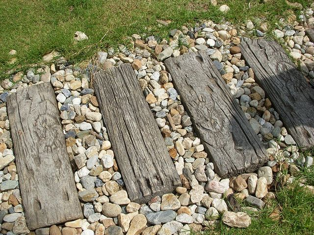 "concrete cast to look like ""old wood"" used as a path with shingle"