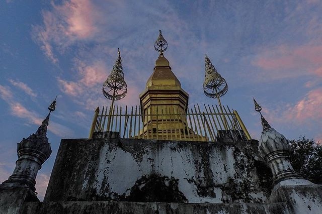 Luang Prabang, Laos Day 56: Mount Phousi is the ideal spot to watch sunset. Unfortunately today was pretty cloudless, but we still managed to get some great colours! #travelintoliving - short, precise destination advice. No wordy blogs! @laospictures