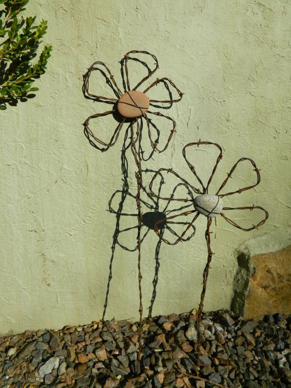 flowers....finally an idea for all that left over fencing wire