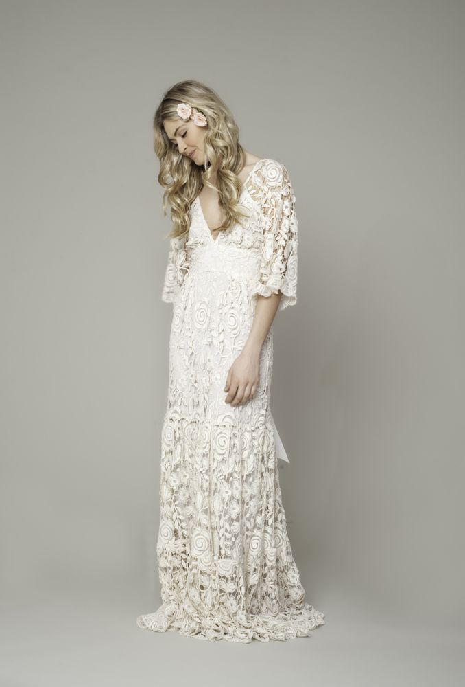 Roses French Lace Maxi Gown 870.00 French lace roses three tier gown with bell sleeve and sash in ivory.