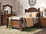 With old world style and fine carved detail, the Mariana 4-piece queen bedroom set calls to the mind the stately look of yesteryear. This set features a rich espresso finish and classic design, which includes antiqued bronze-looking hardware with faux crystal knobs. The handsome silhouette of the arched headboard with picture frame molding is echoed in the mirror's frame for a complete look.