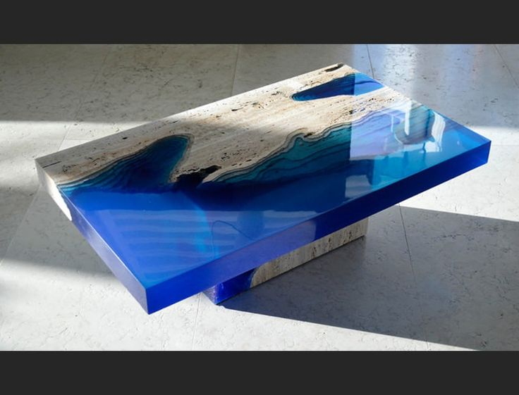 Alexandre Chaplin, a designer from Saint Martin in the Caribbean, has created a collection of tables that reflect the depth and beauty of flowing rivers. H