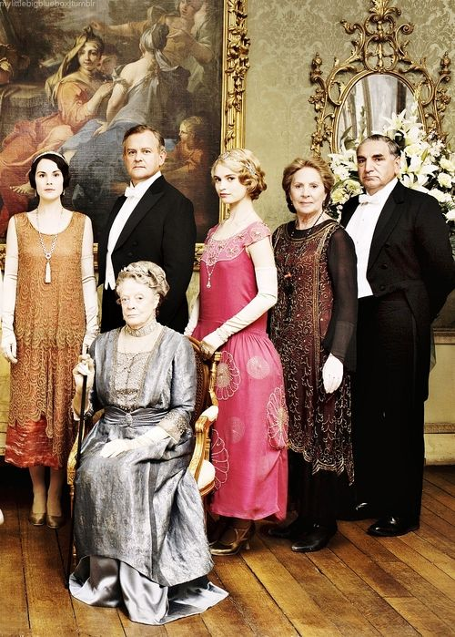 The Dowager Countess seated with, Carson the Butler far right, and members of Her Family from l, the Hon. Lady Mary Crawley, Robert Crawley, the Earl of Grantham, Lady Rose McClare, and Mrs. Isobel Crawley.