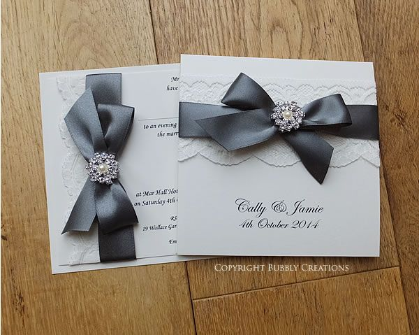 Glamour wedding invitation with lace and pearl embellishment in dark smoked grey.