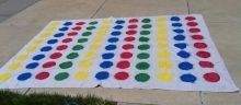 Make a Giant Twister game board (or just put 4 game mats together for 12 players)