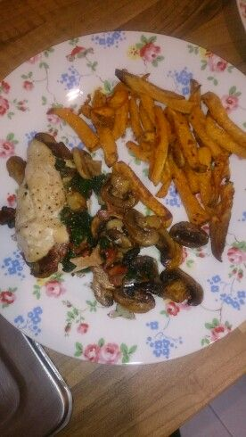 Chicken stuffed wirh mushroom and spinach served with sweet potato fries