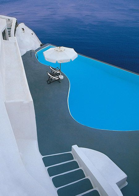 swimming on the edge of the cliff, Santorini, Greece