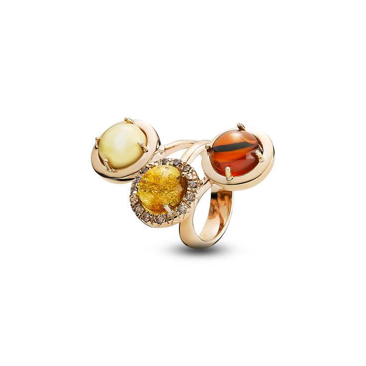 House of Amber - A ring in rose gold silver, zirconia stones and with cognac, cherry and milky amber. The ring is a part of the  Enlightened Enamel Collection.
