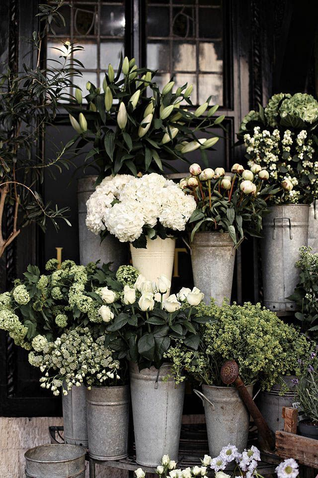 Big buckets of rustic white flowers