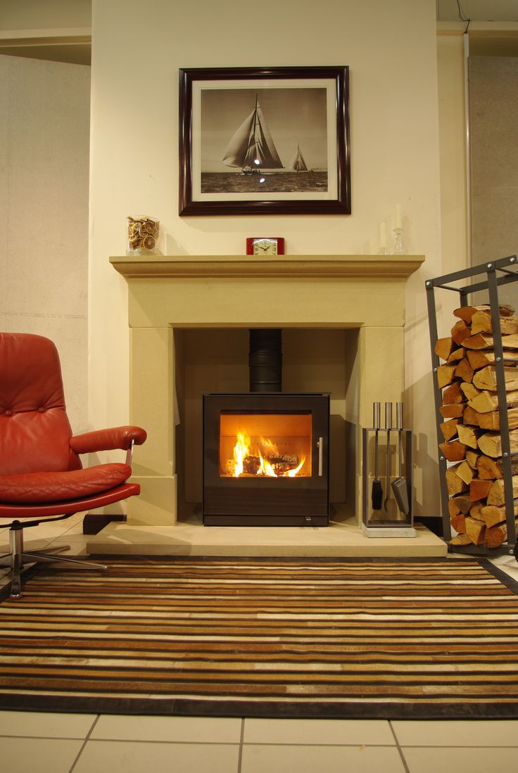 We just love sitting next to a fireplace. #Rais #Stove #Fireplace