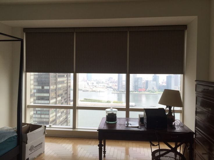 Motorized roller shades by NY City Blinds offer privacy at the touch of a button.