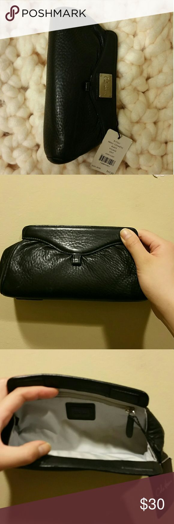 Cole Haan Small cosmetic/clutch Black Vintage Unit Dual use as a cosmetic bag or as a clutch. The item was used a handful of times and comes with original tag. This item was purchased at the 5th Ave store in nyc. The item great condition minus the little scuffs you see in the picture. It can be cleaned out. Cole Haan Bags Clutches & Wristlets