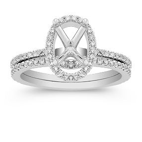Halo Pave-set Diamond Wedding Set - Love that there's the oval possibility and also has room for a skinny wedding band.