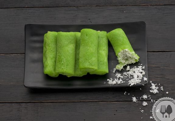 DADAR GULUNG. Rolled crépes filled with grated coconut cooked in coconut sugar