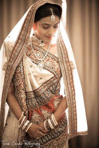 "Gujarati Bride in traditional Bridal dress called ""Panetar"" and traditional real Ivory carved bangles called ""haati daant no chudiyo"""