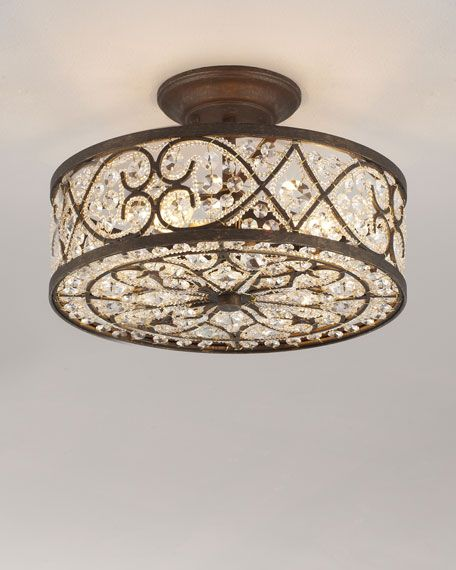 "Mounts to ceiling with a stem or rod; usually hangs 4"" to 8"" below the surface of the ceiling. Polished crystals woven throughout wrought-iron frame with antique-bronze finish. Uses four 60-watt bulbs"