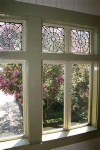 Spider-Web Windows at the Winchester Mystery House in San Jose, CA. Sarah Winchester (1839-1922) was really into spider-web-everything as well as designs representing the number 13.