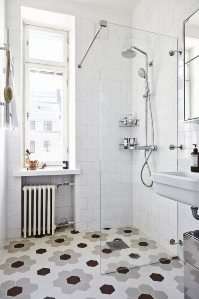 <p>Maximize your space with matching bathroom and shower statement floor tile.</p>