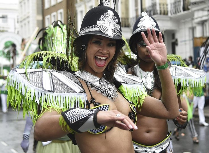 The Notting Hill Carnival in London - A reveller dances as she takes part in the Notting Hill Carnival in west London, August 25, 2014. (Photo by Toby Melville/Reuters)