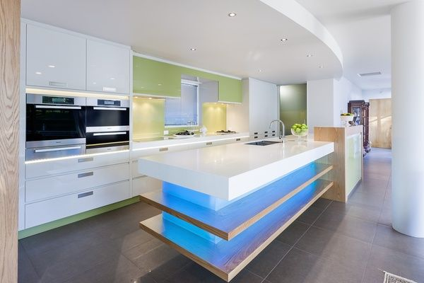Kitchen bench. A sparkle of Resene Flourish is used on the splashback of this kitchen designed by Mal Corboy. Metallic flecks in the glass and sparkling LED lighting heighten the fresh effect. The cabinetry is in Resene Quarter Thorndon Cream.