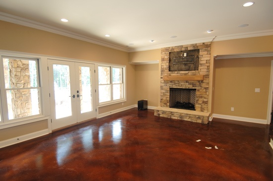 Walk out basement with stained mohagony on concrete floor for Best flooring for walkout basement