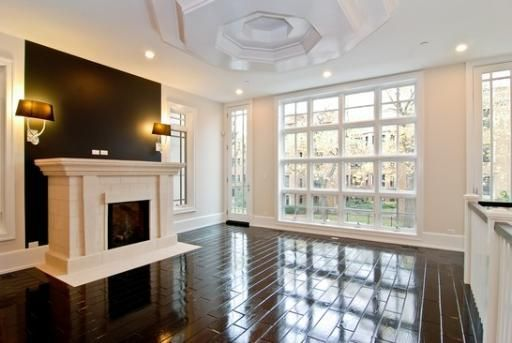 swoon. Love it all: the dark brown lacquered floor, the black wall, the large and open windows, the ceiling's detail, and of course the fireplace.