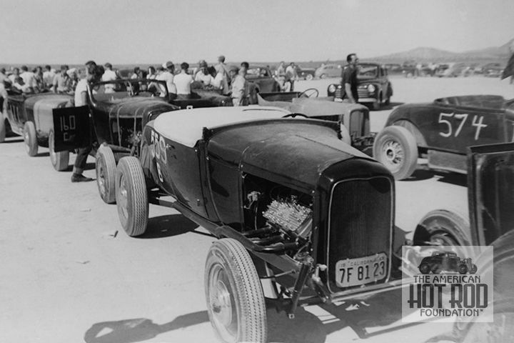 Everybody's ready and waiting at the first S.C.T.A. meet held for 1947 on May 25.   Up front in the number 559 is Stokers member John Kelly's slick looking A that ran in Class B Roadster powered by a Merc fitted with Ord heads. He ran 91.64 mph.   Car number 574 on the right was Almegas member Walter Garlick's B Roadster with Ford power and filled heads. He ran 97.50 mph.   The number 160 C Roadster with the trick windshield on the left is Gophers member Henry Candiotti's A. It was Merc…