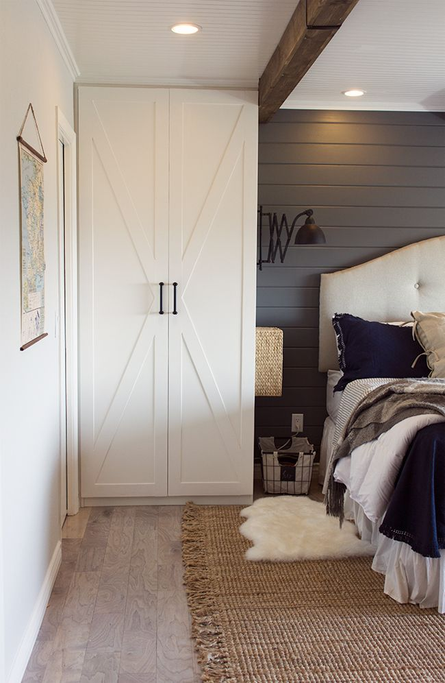 Love Jenna Sue's master bedroom. Dark gray planked wall, white planked ceiling, wooden stained beams, IKEA hacked wardrobes, lovely bedding.