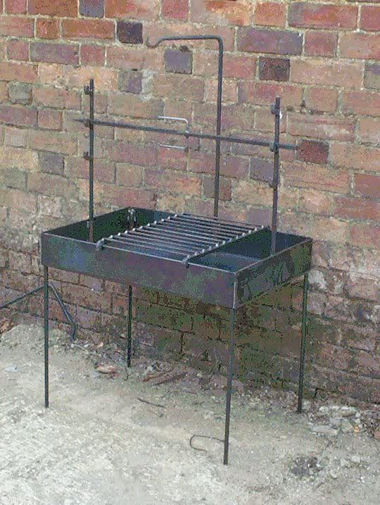 Portable fire pit with pot hanger and rotisserie. Too bad he's in the UK.