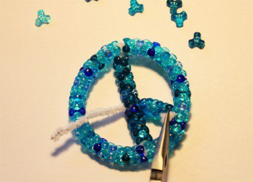 An easy peace ornament bead craft that can be done for Earth Day, a 60's-70's/hippie theme party, or just for those who are a fan of the peace sign symbol and bead craft projects!