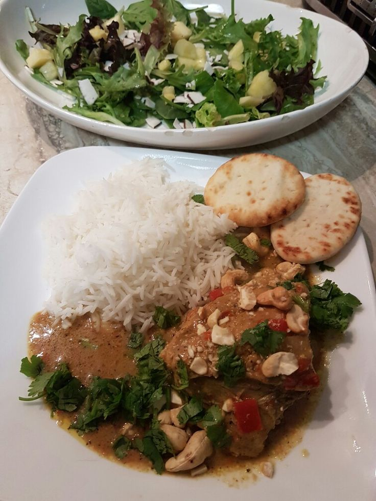 Thai curry topped with cashews and coriander.  Salad with lime dressing pineapple and coconut shavings!
