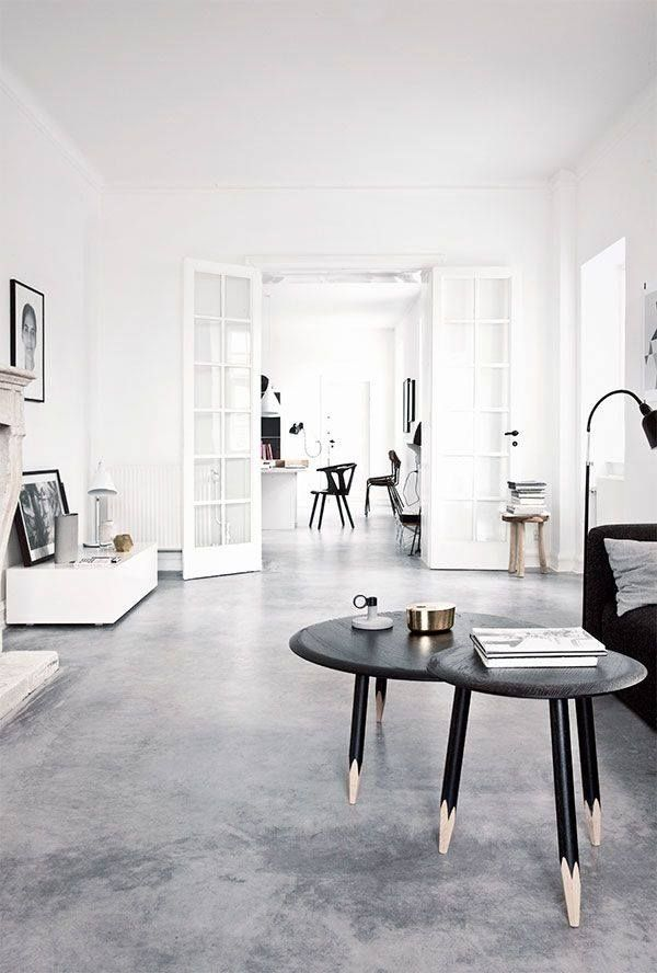 concrete floor, white walls and black furniture for a modern feel