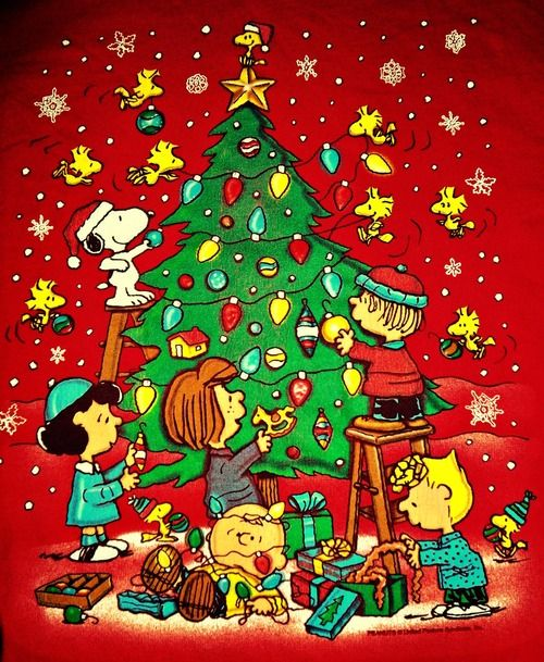 Decorating the Christmas Tree with Snoopy and the Gang.