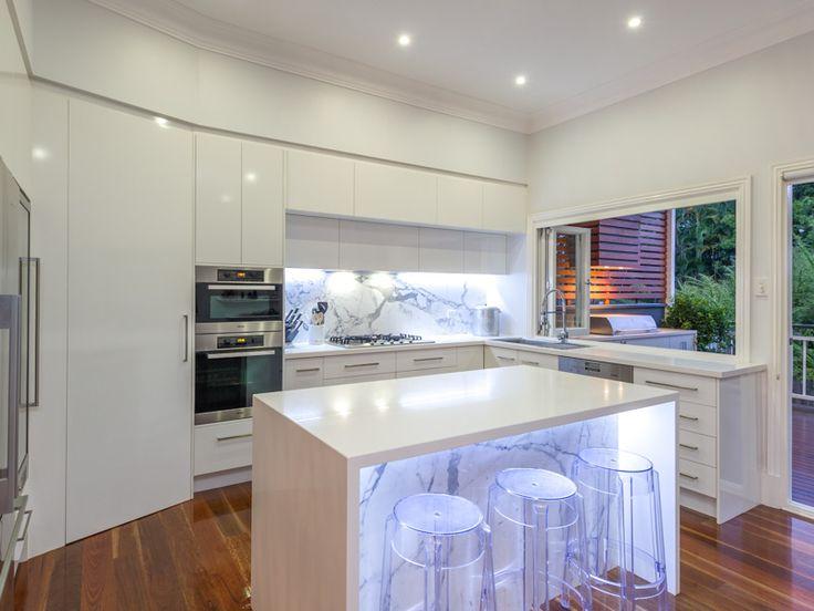 Thats my kitchen White gloss doors White Quartz tops Italian marble splashback