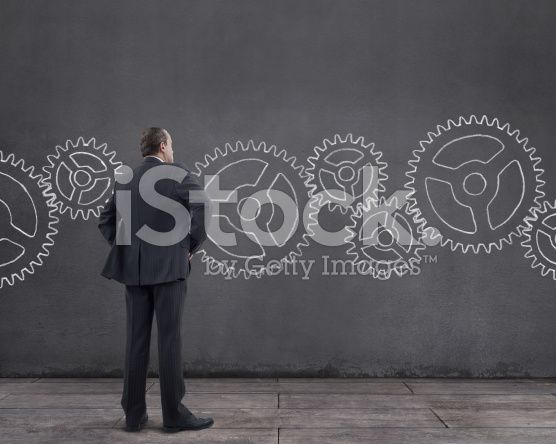 Businessman and Gears (royalty-free stock photo) © mgkaya