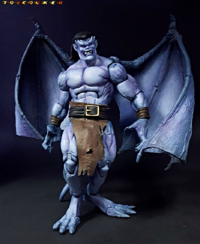 Goliath (Gargoyles) Custom Action Figure by Toycooker He wrote the recipe as follows: Torso-Radioactive Man resculpted chest to make more natural and wider Wings-Mcfarlane Dragon dremelled and attached w fodder hip ball joints for articulation Arms-Odin baf Hands-Antivenom, cut finger off and Resculpted Feet-SMC Lizard smoothed out w sculpt Calm Head- Gladiator cast Resculpted Angry Head-Blanka Resculpted