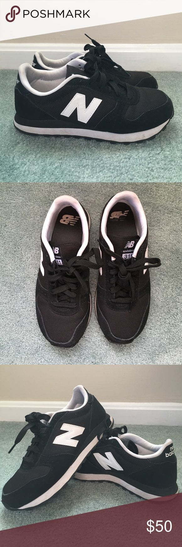 Black New Balance 311 New Balance 311 in great condition. Worn a couple times. New Balance Shoes Athletic Shoes