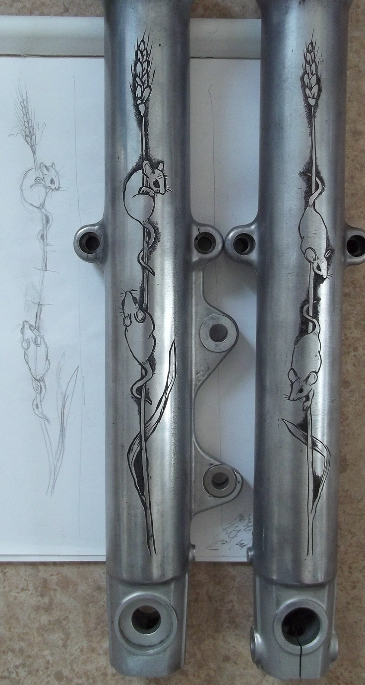 hand engraved motorcycle parts - lower front legs of Harley - the bike had burned down because of mice in the wiring - the bike's owner plans to restore the motorcycle and customize it with a mouse theme - all handwork, no machines - semperparatus13@aol.com