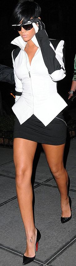 Rihanna...looking like a female Jay-Z! love it!!